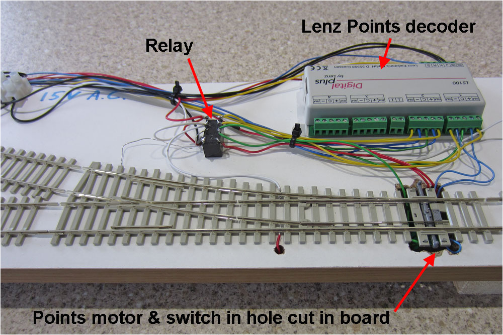a relay is used to provide two independent switches one for frog supply and the other to provide the feedback input to the decoder